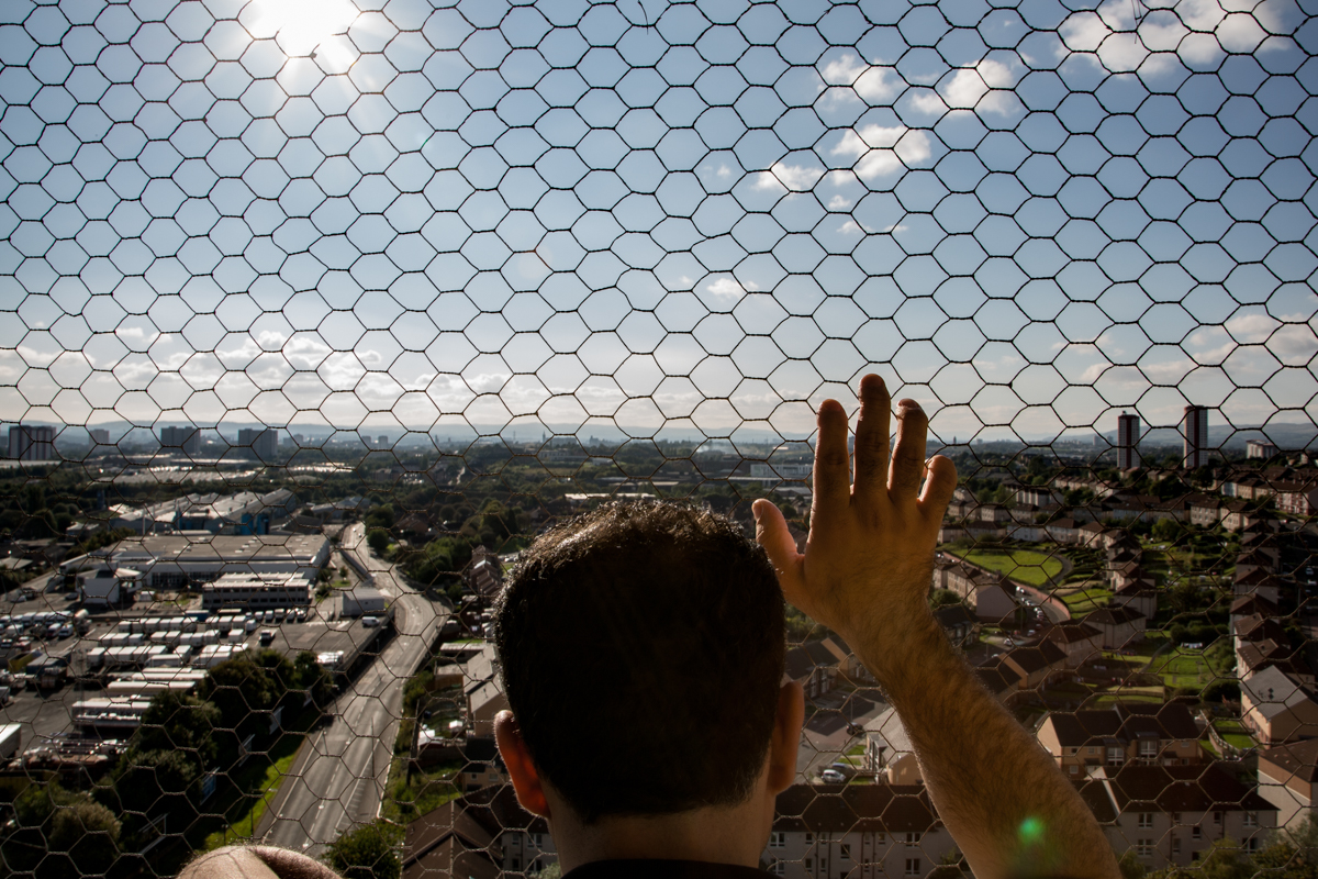 One of the last residents of the now demolished Red Road Flats looks across the city